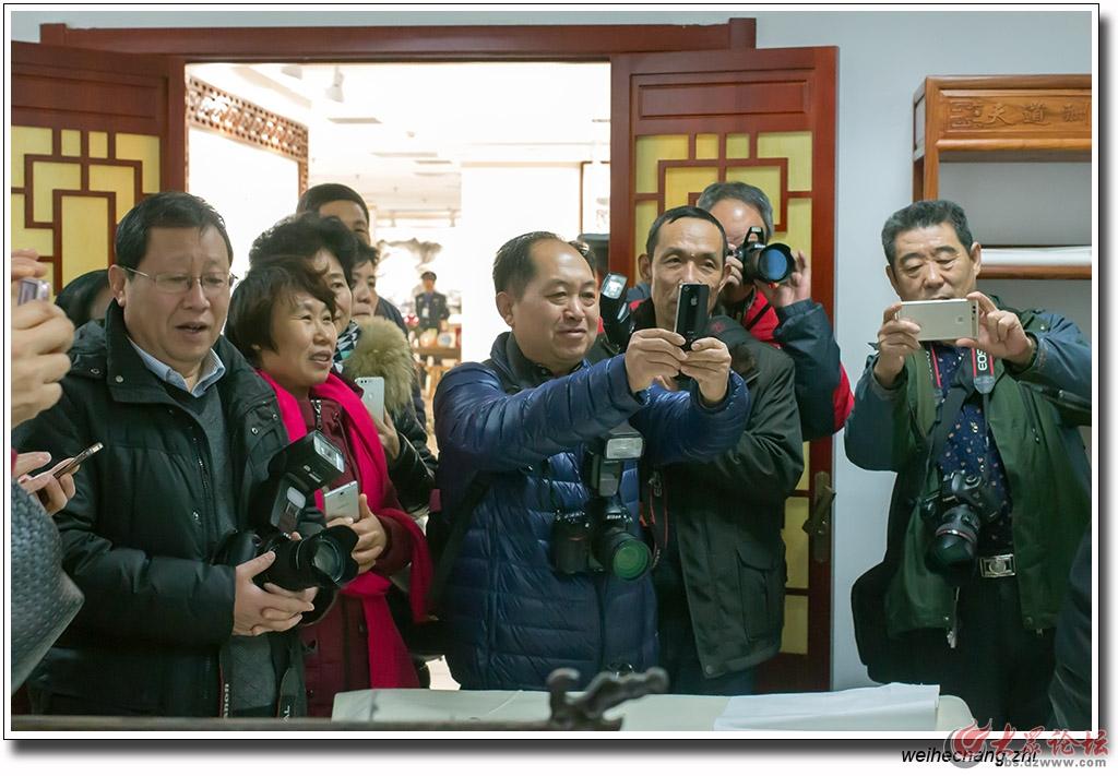 安丘市老年摄影学会走进辅唐文化艺术中心1.jpg