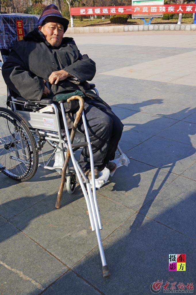 费县赠送轮椅活动12..jpg